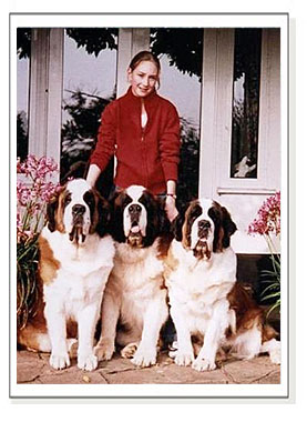 three champion dogs and girl